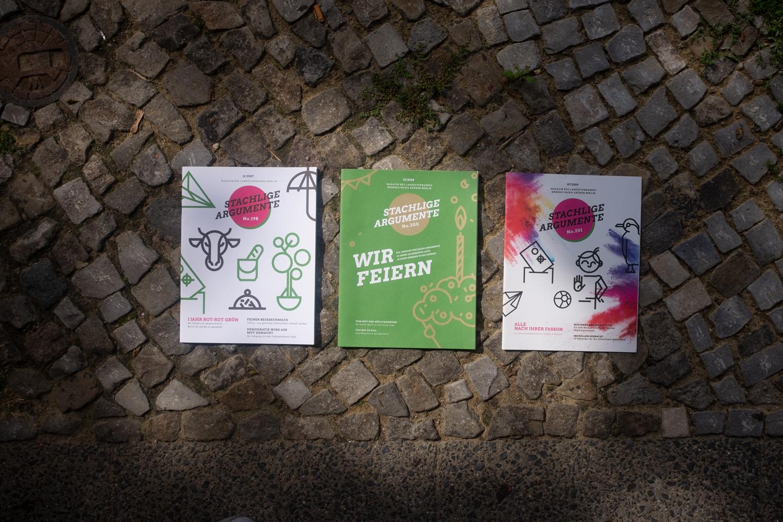 printed magazines on sidewalk