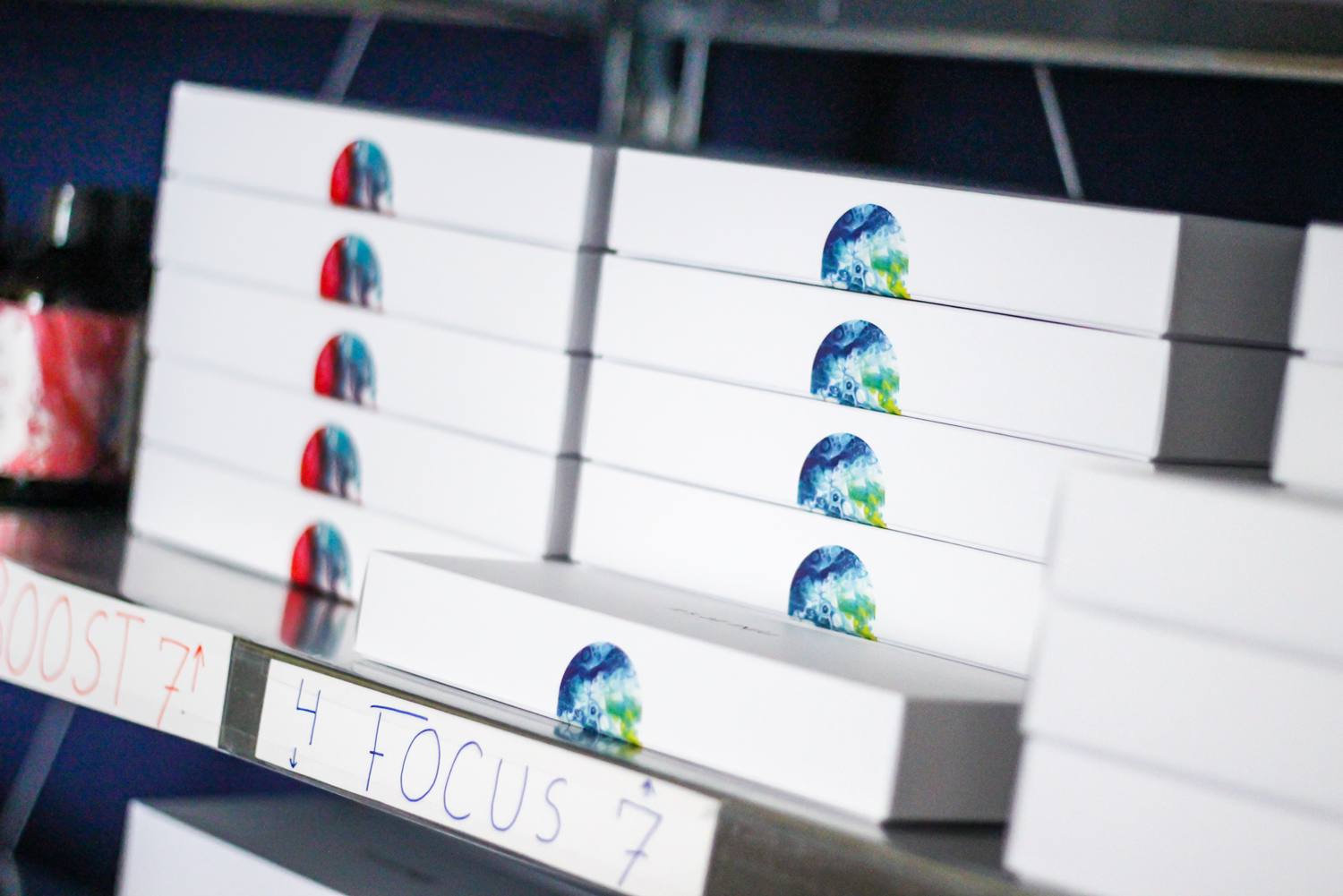 stacked paper boxes with stickers