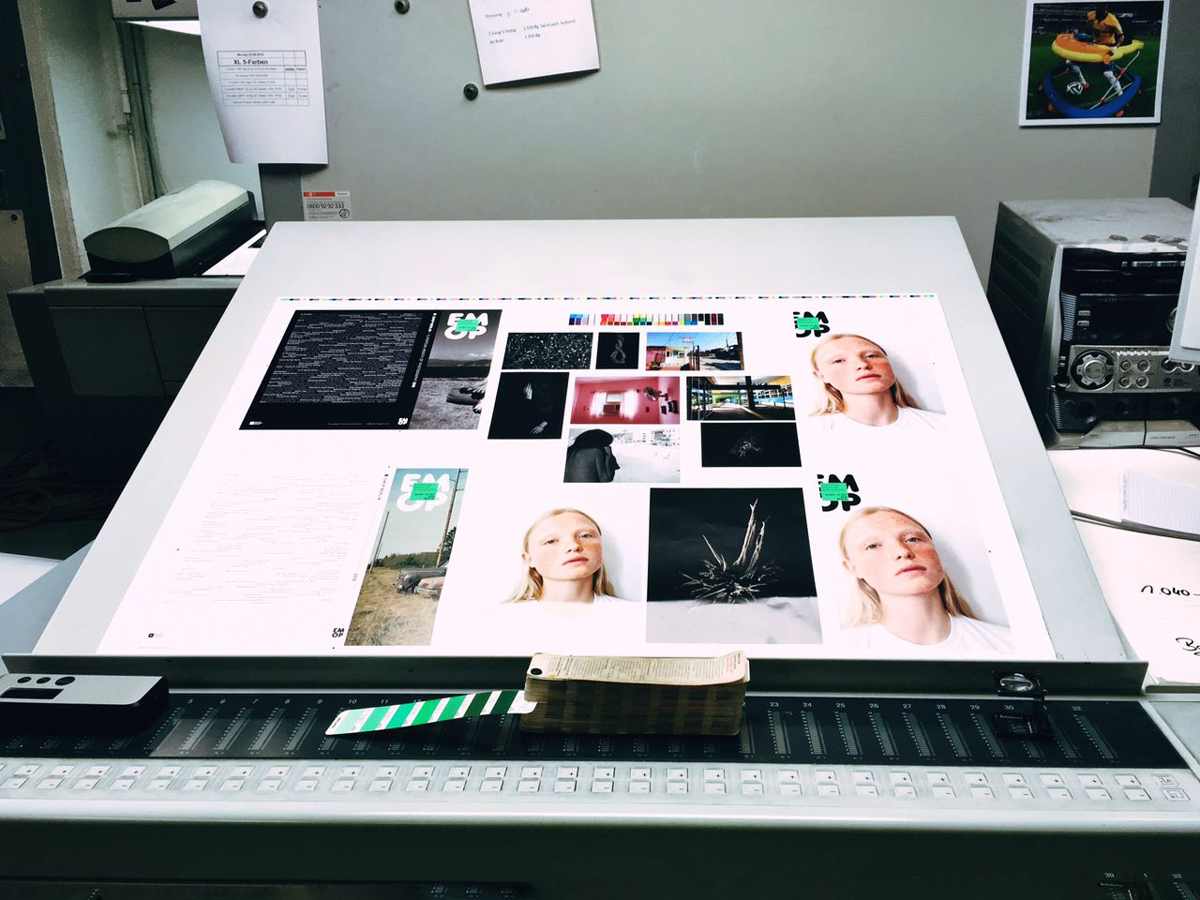 paper with printed pictures laying on table